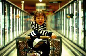 smiling-boy-shopping-cart-copy